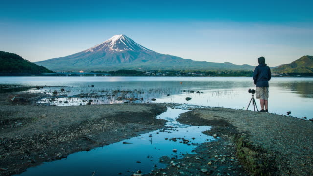 photographing mount fuji - one mid adult man only stock videos & royalty-free footage