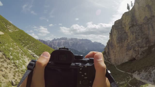 pov photographing the dolomites with digital camera - digital camera stock videos & royalty-free footage