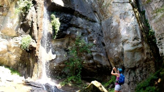 photographing the waterfall - drakensberg mountain range stock videos & royalty-free footage