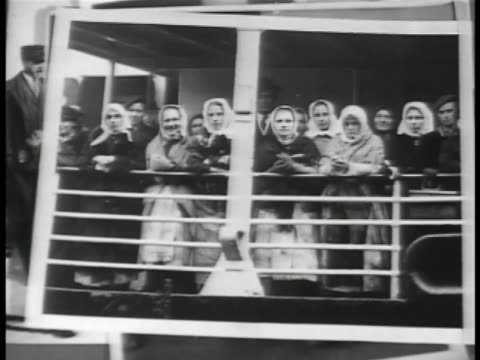 Photographs of immigrants at ship's railings MOT 1906 Immigrants walking on ship arriving at Ellis Island Mother sitting w/ other children smiling...