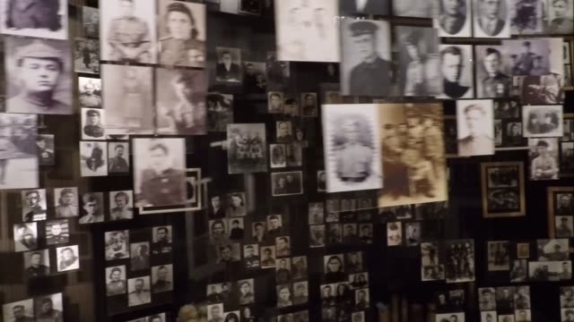 photographs of people killed during battles with nazi germany at an exhibition dedicated to ww2 inside the national museum of the history of ukraine... - 博物館点の映像素材/bロール