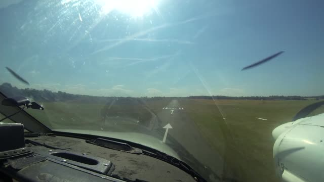 above london aerial photographer ian hay int reporter seated in cockpit of aircraft as in flight looking unwell povs light aircraft landing ian hay... - hay stock videos & royalty-free footage
