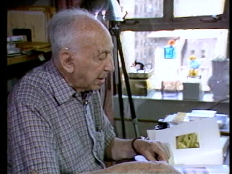 andre kertesz interview; andre kertesz interview sot - discusses how memory of his wife inspired his glass obkect photographs cutaway polaroid... - polaroid stock videos & royalty-free footage