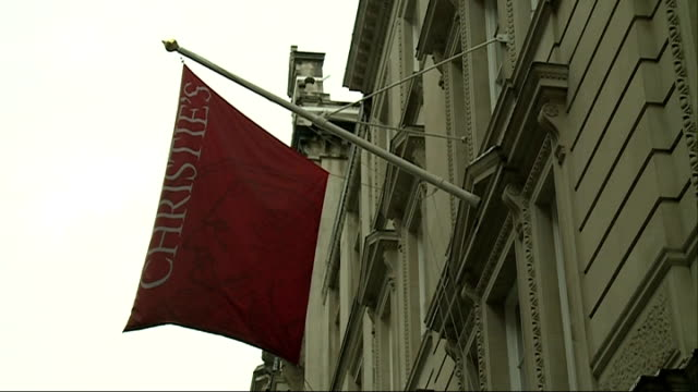 Auction of photographic prints at Christie's EXT Flag flying outside Christie's auction house