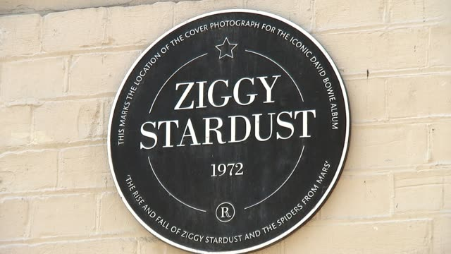 david bowie photographic exhibition england london heddon street the hub ext gvs the hub gallery with 'david bowie' sign in window/ 'ziggy stardust'... - memorial plaque stock videos and b-roll footage