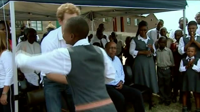 prince harry photographs from lesotho charity trip; lib / t27021314 / t27021325 lesotho: int prince harry writing on blackboard during school visit... - school child stock videos & royalty-free footage