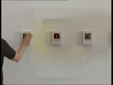 richard hamilton polaroid exhibition england birmingham ikon gallery overlay polaroid snapshots of richard hamilton in display in art exhibition as... - curator stock videos & royalty-free footage