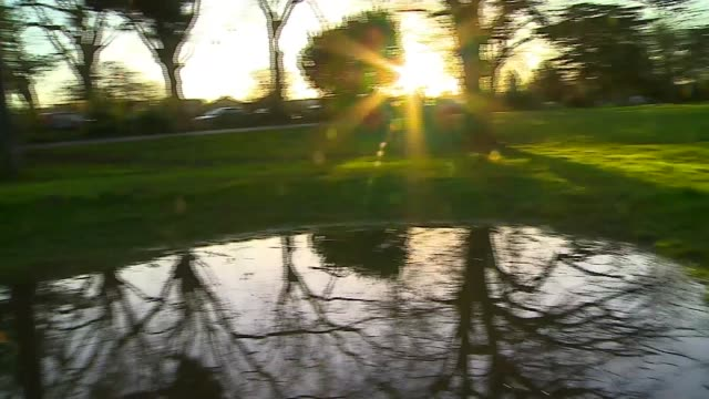 the photographer who captures london's mornings; england: london: ext shaky camera reporter trying to replicate photo of sunrise in pond gv ben james... - shaky stock videos & royalty-free footage