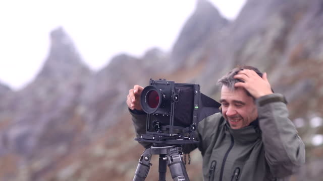 Photography with the old school camera in the mountains.