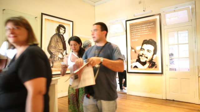 Alta Gracia Argentina February 08 2012 Photos of Che in the entrance area tourists are informing themselves Che Guevara Museum in Alta Gracia Cordoba...