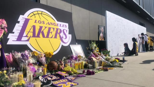 photos show a memorial outside the lakers training center in el segundo california that includes a large white wall where fans have written tributes... - el segundo stock videos & royalty-free footage