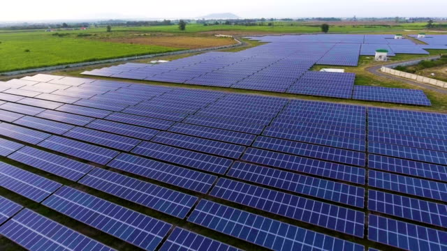 photovoltaic panels in solar power station with sunlight and reflection - control panel stock videos and b-roll footage