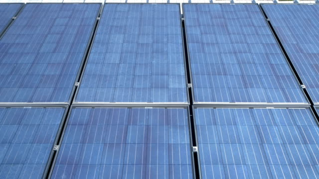photovoltaic solar cells on rooftop producing clean renewable energy on a sunny day gliding across solar panels - roof stock videos and b-roll footage