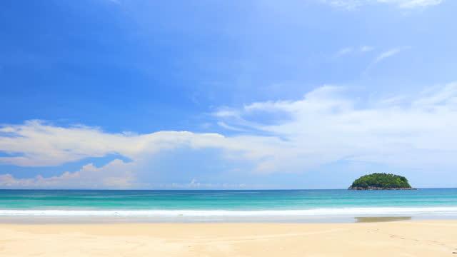 phuket beach sea, view of beach sea on sun light in the summer. at kata beach, phuket, thailand. - sunny stock videos & royalty-free footage