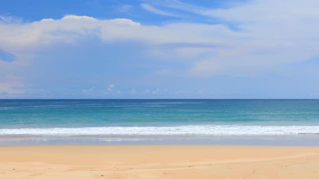 phuket beach sea, view of beach sea on sun light in the summer. at kata beach, phuket, thailand. - thailand stock videos & royalty-free footage