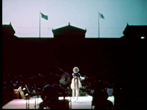 stockvideo's en b-roll-footage met phyllis diller at microphone on outdoor stage / philadelphia pennsylvania usa - sociale geschiedenis
