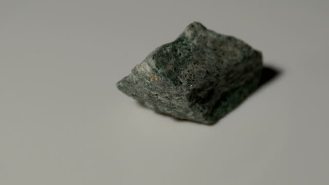 phyllite slate mineral sample in rotation with white background - rock object stock videos and b-roll footage