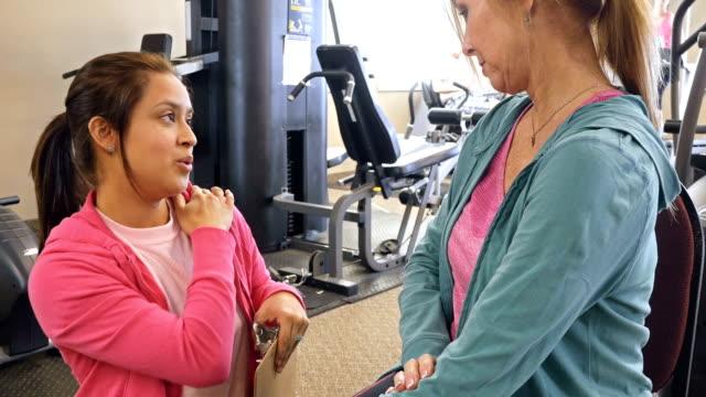 Physical therapist evaluates senior female client