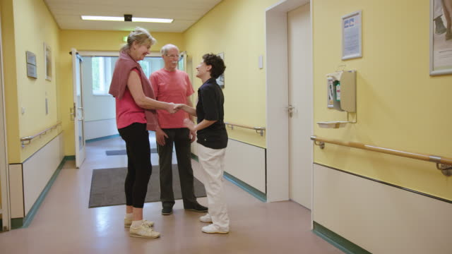 physical therapist greeting patients at clinic - medical examination room stock videos & royalty-free footage