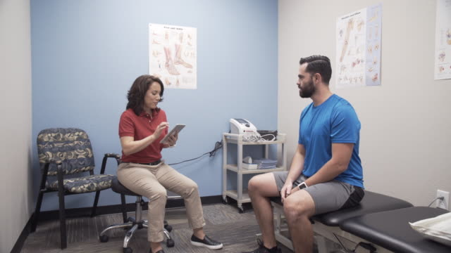physical therapy consultation 7 - physical therapy stock videos and b-roll footage