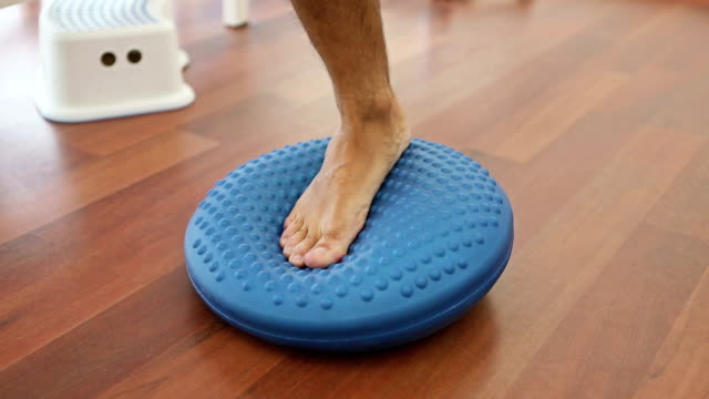 Physical therapy on rubber balance ball