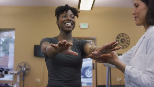 physical therapy session with women of color - physical therapy stock videos & royalty-free footage