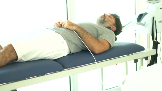 physical therapy with traction equipment - cervical vertebrae stock videos & royalty-free footage