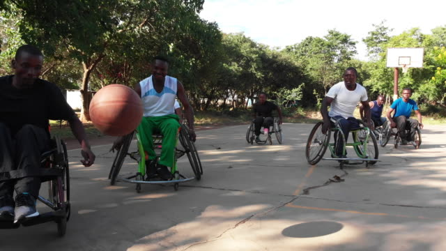physically challenged african wheelchair basketball players playing a friendly match - wheelchair basketball stock videos & royalty-free footage