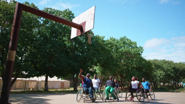 physically challenged african wheelchair basketball team playing a friendly match - wheelchair basketball stock videos & royalty-free footage