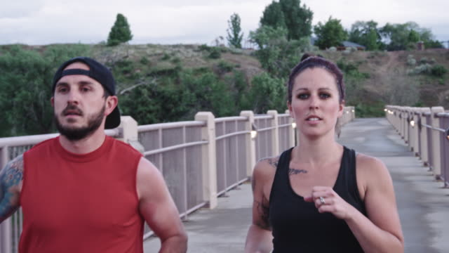 Physically Fit Caucasian Couple in their Thirties Running