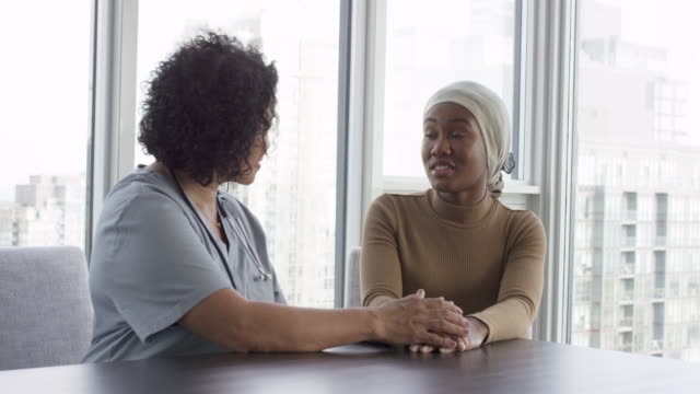 physician consults female cancer patient - consoling stock videos & royalty-free footage