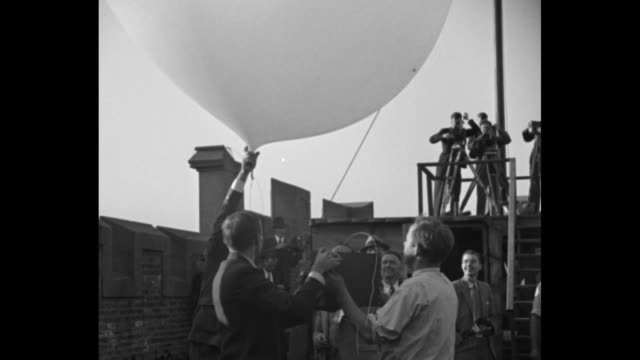 Physicist Arthur Compton and his team release balloon with attached box and it flies into the atmosphere