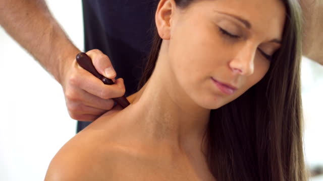 physio therapy against neck pain - menschlicher hals stock-videos und b-roll-filmmaterial