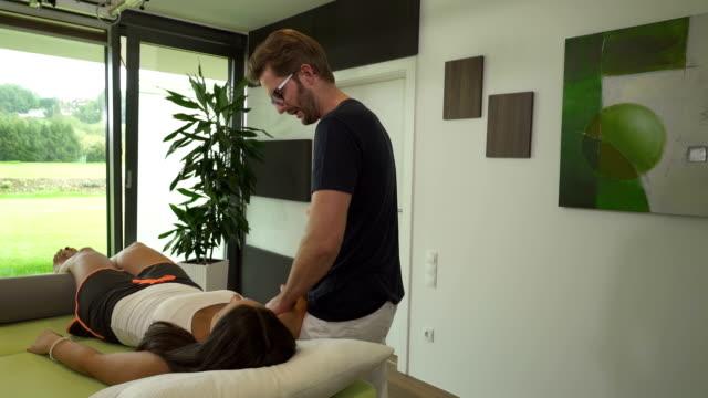 physiotherapist doing treatment - human limb stock videos & royalty-free footage