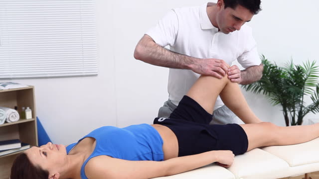 physiotherapist manipulating a knee - ligament stock videos and b-roll footage