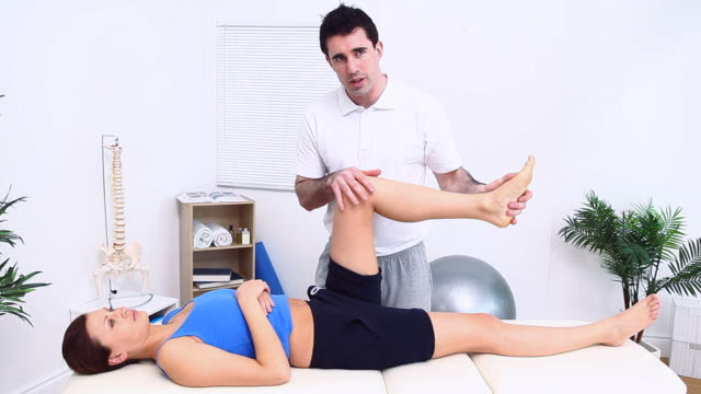 physiotherapist massaging the knee of a patient - ligament stock videos and b-roll footage
