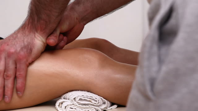 physiotherapist massaging the upper part of the knee of a patient - ligament stock videos and b-roll footage