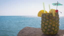 Piña Colada Served in a Fresh Pineapple at a Beach Resort in 4k