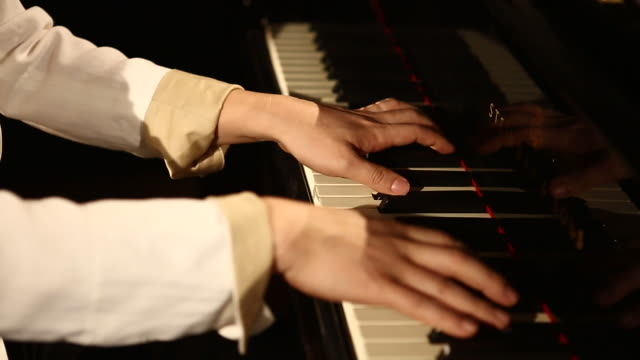 Pianist hand playing piano