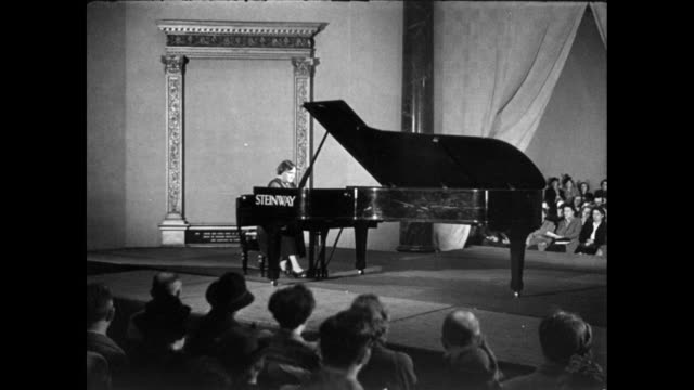 vidéos et rushes de montage pianist, myra hess, playing piano for a birthday concert on stage in front of an audience / england, united kingdom - piano