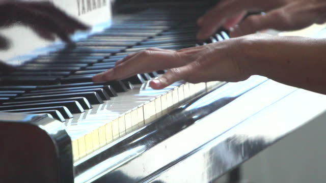 Pianist Playing Grand Piano with Cinematic Stage Lighting