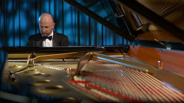 hd: pianist playing the grand piano - pianist stock videos & royalty-free footage