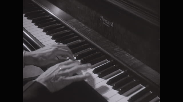 cu ha pianist playing the piano / united states - ピアノ点の映像素材/bロール