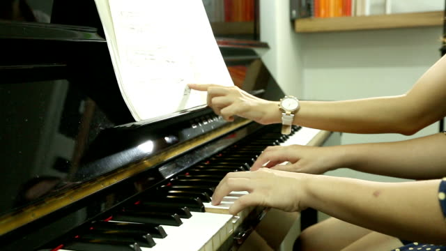 Pianist teacher teaching and playing music