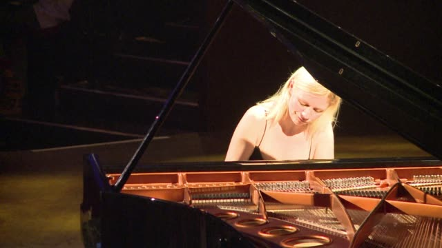 a pianist who launched her career by posting videos of herself on youtube translated her online success into reality with a solo performance at one... - solo performance stock videos and b-roll footage