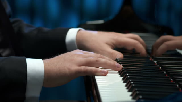 hd dolly: pianist's hands - piano stock videos & royalty-free footage