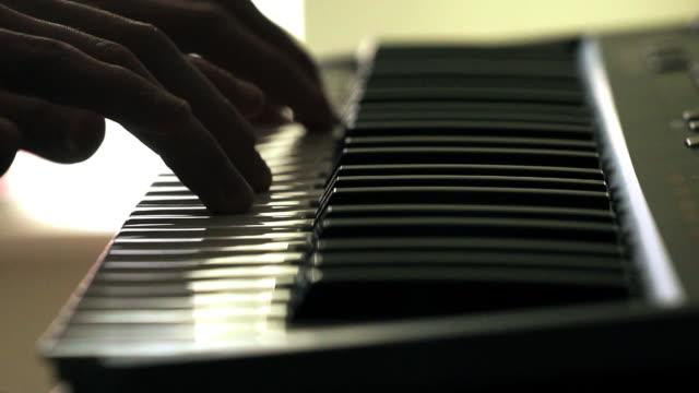 piano closeup - pianist stock-videos und b-roll-filmmaterial
