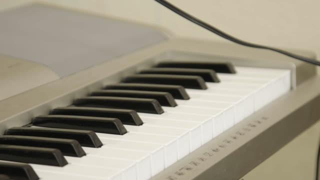 Piano keyboard keys, close up
