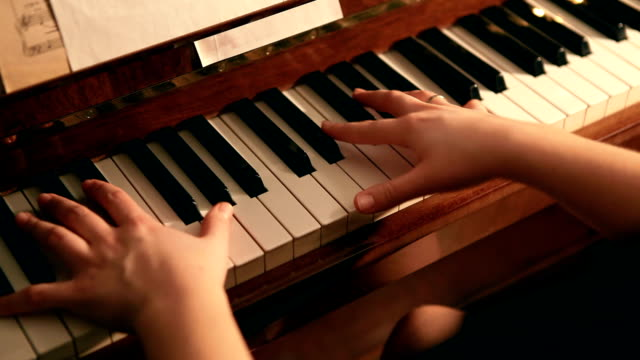 Piano play close up hands shot