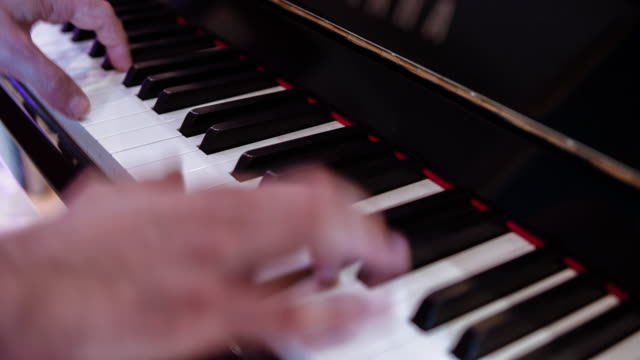 piano player playing his composition.  professional recorded sound. - human finger stock videos and b-roll footage